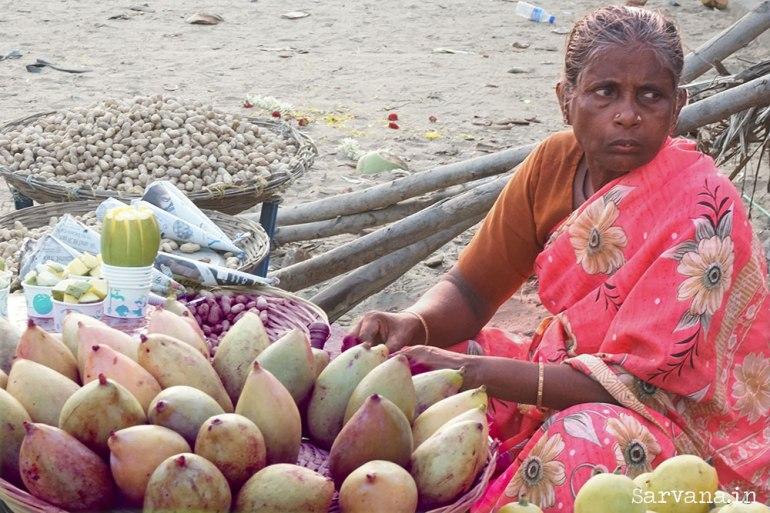 Woman Selling Mangoes